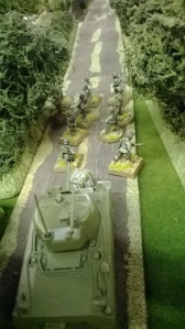 Help arrives, two Shermans silence the roadside defenders...