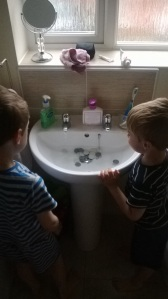 0800 hours- bathroom fun includes washing wargame bases in sink.