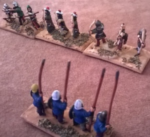 The moors mass their crossbows against the stout Christian spearmen.